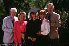 A graduate with family; Actual size=240 pixels wide