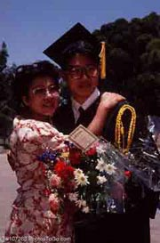 A graduate with his sister; Actual size=180 pixels wide